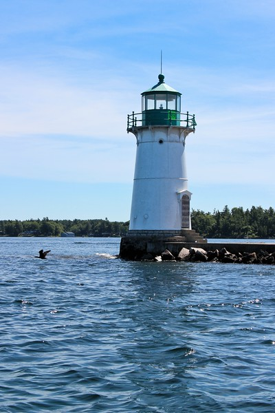 In 1882 a new 30 foot cast iron lighthouse was constructed at Sunken Rock to replace the old 1847 tower.  Similar towers were also constructed in 1882 at Rock Island and Crossover Island.    The tower was lined with brick to the first landing and then lined with wood to the lantern room.
