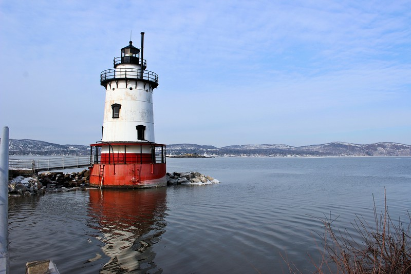 Over the years the area between the shore and the lighthouse was filled in by silt from the Pocantico River and landfill until the tower was only 50 feet from land.  After the completion of the Tappan Zee Bridge, in 1955 1 mile away, the light in the lantern was downgraded in 1957.  In 1961 the Coast Guard decided to decommission the lighthouse and removed the Keeper.