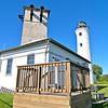 Commencing in 1890 the Lighthouse Board requested funds to erect a fog signal at the Tibbetts Point Light Station.  The request was repeated every year until the monies were appropriated in 1895.  It took until 1897 to build the 36 feet by 22 feet brick fog signal house to house a steam whistle.  In 1927 the fog signal was converted to an air diaphone.  The fog signal was discontinued in 1972 in favor of a radiobeacon.