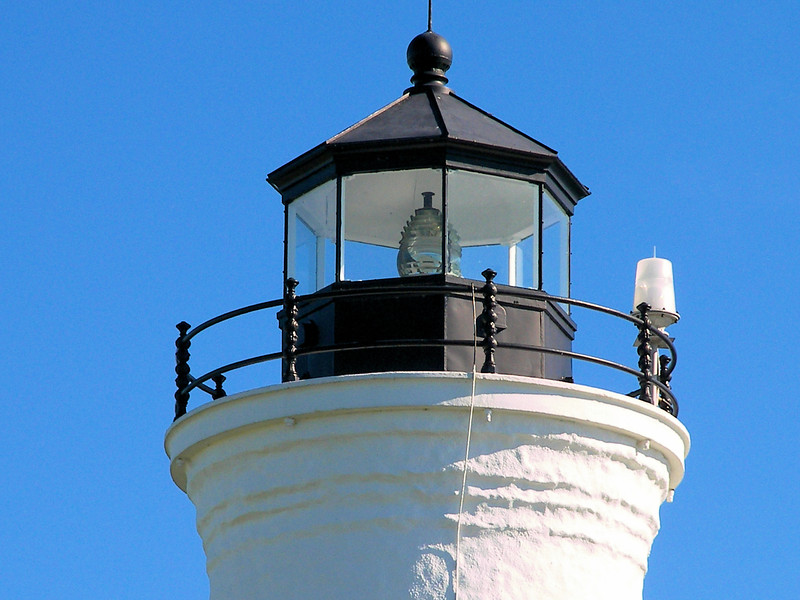 The lantern was outfitted with the second Fresnel lens on the Great Lakes, a fixed 4th Order lens.  The new tower was lit up for the first time on August 1, 1854.  In 1869 the tower was covered in cement to provide additional strength to the structure.