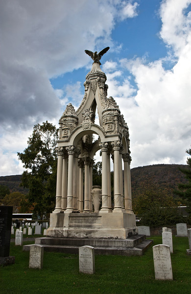 "Daniel Butterfield's Grave, United States Military Academy at West Point, New York <br><br> The cemetery was one of the highlights of our tour of the U.S. Military Academy at West Point in the fall of 2011. Notable people buried there include football coach Red Blaik, Lucius Clay (father of the Berlin Airlift), George Custer, Frederick Grant (son of U.S. Grant), Winfield Scott, and William Westmoreland.  <br><br> One of the most prominent and ornate gravesites is Daniel Butterfield's, the composer of the bugle call Taps. Taps used to signal lights out at the end of the day and is played by the military at funerals and memorial services. The 24-note bugle call is sad and haunting; I feel like crying every time I hear it. Here is an audio clip from <a href=""http://www.armystudyguide.com/content/army_board_study_guide_topics/customs_and_courtesies/bugler-playing-taps-in-mp3.shtml"">Army Study Guide.</a>  <br><br> From <a href=""http://www.west-point.org/taps/Taps.html"">WestPoint.org</a>, ""Daniel Adams Butterfield (31 October 1831-17 July 1901) was born in Utica, New York and graduated from Union College at Schenectady. He was the eastern superintendent of the American Express Company in New York when the Civil War broke out. Despite his lack of military experience, he rose quickly in rank. A Colonel in the 12th Regiment of the New York State Militia, he was promoted to Brigadier General and given command of a brigade of the V Corps of the Army of the Potomac. The 12th served in the Shenandoah Valley during the Bull Run Campaign. During the Peninsular Campaign Butterfield served prominently when during the Battle of Gaines Mill, despite an injury, he seized the colors of the 83rd Pennsylvania and rallied the regiment at a critical time in the battle. Years later, he was awarded the Medal of Honor for that act of heroism. <br><br> As the story goes, General Butterfield was not pleased with the call for Extinguish Lights feeling that the call was too formal to signal the days end and with the help of the brigade bugler, Oliver Willcox Norton, wrote Taps to honor his men while in camp at Harrison's Landing, Virginia, following the Seven Day's battle. These battles took place during the Peninsular Campaign of 1862. The call, sounded that night in July, 1862, soon spread to other units of the Union Army and was even used by the Confederates. Taps was made an official bugle call after the war."" <br><br> After the war, President Grant appointed him to Assistant Treasurer of the U.S. He was involved in the Black Friday gold scandal. Butterfield told Jay Gould when the government was planning to sell gold. Gould and James Fisk wanted to cover the gold market with the information and sold gold before prices dropped. Grant uncovered the plan and sold $4 million of government gold without telling Butterfield, resulting the panic of collapsing gold prices known as Black Friday, on September 24, 1869. See  <a href=""http://en.wikipedia.org/wiki/Daniel_Butterfield"">Wikipedia</a> for more detail."