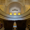 """Grant's Tomb <br><br> Grant's Tomb is located near Riverside Church at 122nd and Riverside Ave. After Grant died in 1885, there were several possibilities for a burial site: St. Louis where Grant had lived before the Civil War, Galena, Illinois, which was Grant's home from before the Civil War until after his presidency, and New York City, where Grant lived in his last four years. Before he died, Grant ruled out West Point because his wife Julia could not be buried beside him. The Grant family chose Riverside Park after ruling out Central Park.  <br><br> Grant's funeral attracted 60,000 marchers that stretched seven miles and took five hours to pass. Over one million spectators witnessed the parade. Attendees included President Grover Cleveland, his cabinet, justices of the Supreme Court, high level figures in the Civil War, and every member of Congress. Grant's remains were placed in a temporary vault in Riverside Park.   <br><br> The day after his death the mayor of New York City wrote a letter to prominent New Yorkers for support for a National Monument in Grant's honor. A committee was established called the Grant Monument Association (GMA) and headed by ex-President Chester A. Arthur. Early fundraising efforts were slowed by a negative public opinion expressed by out of state press questioning why local residents should help finance a monument in wealthy New York City. Some believed the monument should be in Washington D.C. and some criticized the GMA for not donating enough to support the cause. Not having a concrete plan for a memorial hurt fundraising as donations lagged financial goals by a substantial amount. <br><br> Finally in 1888, the GMA announced a design competition. John Hemenway Duncan won the contest. The objective of his design was to """"produce a monumental structure that should be unmistakably a tomb of military character."""" The estimated cost was between $500,000 and $900,000. The interior is similar Les Invalides in Paris while the exterior is """