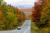 Roadways in the Adirondack Mountains with fall foliage color in New York State, USA.