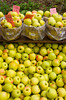 Baskets of green apples for sale at Alyce and Rogers Fruit Stand in Mount Tremper, New York, USA.