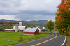 A red barn on a farm in rural New York state Catskill mountains.