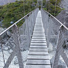 The second swing bridge at dusk on the return trip along the Hooker Valley Trail in Aoraki / Mt. Cook National Park, New Zealand.