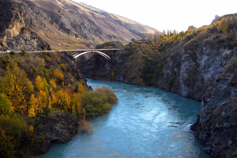 """Kawarau River outside of Queenstown, New Zealand along Route 6.  Just under the bridge is the """"River Anduin"""" where the """"Pillar of the Kings"""" appeared in the Fellowship of the Ring."""