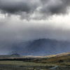 Dramatic rainfall in the Rangitata Valley in the Canterbury Plains, New Zealand.   Mt. Sunday, the location for Edoras in the Lord of the Rings trilogy, can be seen in the valley and the iconic Helms Deep location is to the left being devoured by the rain.