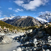 Hooker Valley Glacier Lake emptying into a river which flows throughout the Aoraki / Mt. Cook National Park, New Zealand.
