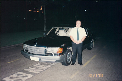 Cairns: limo from airport to hotel - John is the driver of the Mercedes 420 SEL