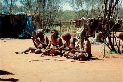 Alice Springs: Dreamtime and Bushtucker Tour - Aboriginal men performing ceremonial singing