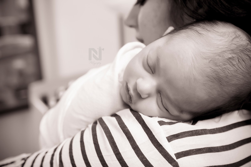 Gorgeous baby sleeping on the shoulders of his mom so safe - Newborn photography