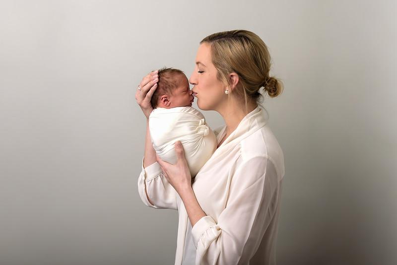 Top Cincinnati Newborn Photographer first time mom kissing baby boy