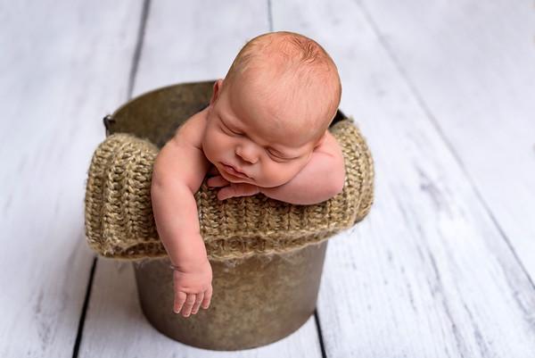 Top Cincinnati Newborn Photographer Boy in a metal bucket