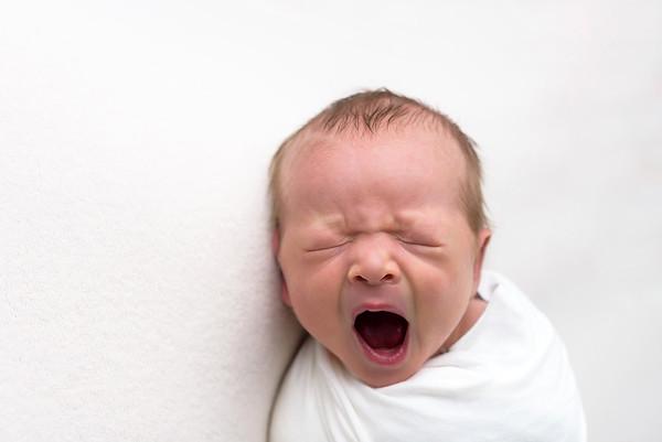 Newborn Photography Cincinnati Baby Boy Yawning Lifestyle
