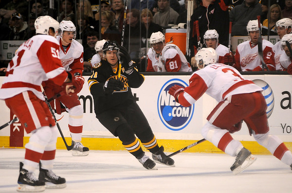Boston: Bruins forward P.J. Axelsson (11) weaves through a trio of Red Wing defenders during Boston's 4-1 victory on November 29, 2008. Photo by Ben Laing/Newburyport Daily News Saturday November 29, 2008.