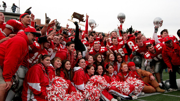 Waltham: Amesbury's players, coaches, and cheerleaders celebrate after winning the state championship over Martha's Vineyard on Saturday. Photo by Ben Laing/Newburyport Daily News Saturday December 6, 2008.