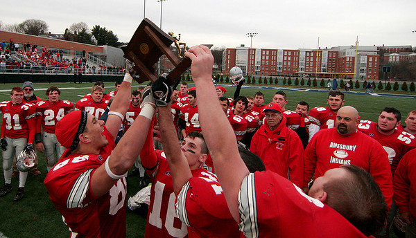 Waltham: Amesbury's team captains hoist the state championship trophy high in the air after beating Martha's Vineyard 40-20 at Bentley University Saturday afternoon. Photo by Ben Laing/Newburyport Daily News Saturday December 6, 2008.