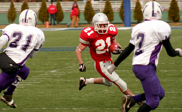 Waltham: Amesbury running back Kevin Johnston (21) runs past the Martha's Vineyard defense on his way to the end zone in Saturday's 40-20 victory for the state championship. Photo by Ben Laing/Newburyport Daily News Saturday December 6, 2008.
