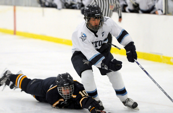 Byfield: Triton captain Craig White (9) slips past a diving Lynnfield defender during last night's game at Governor's Academy. Photo by Ben Laing/Newburyport Daily News Monday December 22, 2008.
