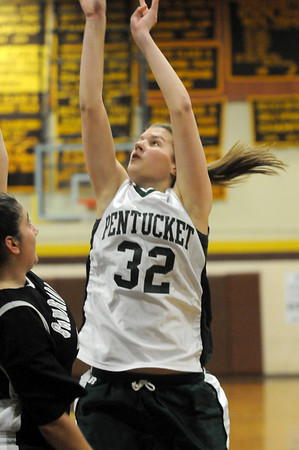 Haverhill: Pentucket's Kirsten Daamen (32) releases a shot over a Cambridge defender during Monday night's game at Haverhill High School. Photo by Ben Laing/Newburyport Daily News Monday December 29, 2008.