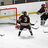 Newburyport: Newburyport's Kevin Holmes (19) watches his shot find the the back of the net just 16 seconds into Monday's game against Amesbury at the Graf Rink. Photo by Ben Laing/Newburyport Daily News Monday December 29, 2008.