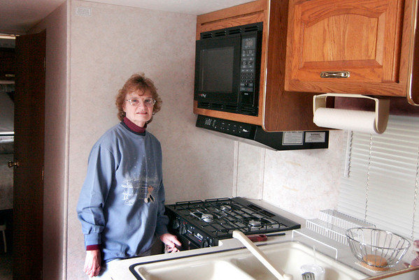 Amesbury: Jane Millette, an Amesbury resident, shows where she and her husband cooked their meals this weekend, as their home has been with out power since Friday. The couple used the kitchen in their RV to make dinner and stay warm. Photo by Ben Laing/Newburyport Daily News Monday December 15, 2008.