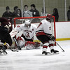 Newburyport: Amesbury goalie Matthew Irwin couldn't keep Newburyport's Kyle McElroy (3) out of the net as the Clipper junior complete his hat trick on this shot in the second period. Newburyport won the game 7-0 at the Graf Rink Monday afternoon. Photo by Ben Laing/Newburyport Daily News Monday December 29, 2008.
