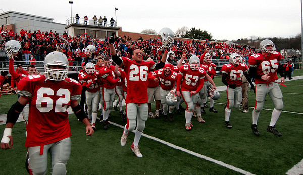 Waltham: Amesbury players rush the field at the end of their 40-20 Superbowl victory over Martha's Vineyard. Photo by Ben Laing/Newburyport Daily News Saturday December 6, 2008.