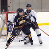 Byfield: Triton captain Caleb Woodworth (23) battles with Lynnfield's Greg Meininger (6) in front of his net during Monday night's game at Governor's Academy. Photo by Ben Laing/Newburyport Daily News Monday December 22, 2008.