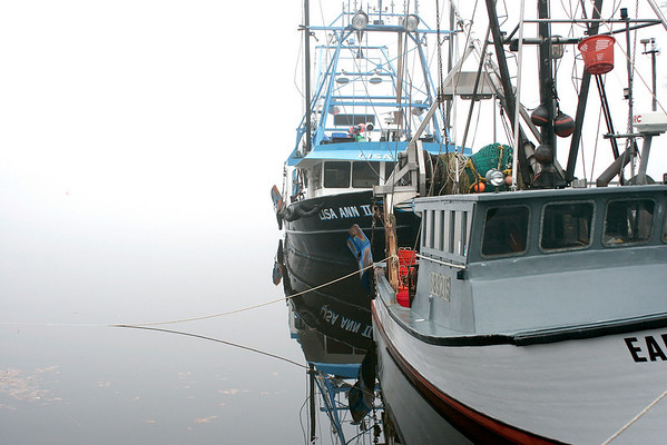 Newburyport: With the area socked in by thick fog, these local fishing boats remain docked along the boardwalk in Newburyport. Photo by Ben Laing/Newburyport Daily News Monday December 1, 2008.