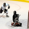 Haverhill: Newburyport's captain, Kevin Holmes (19) get ready to fire a shot on Pentucket goalie Andrew Mueskes during Thursday nights game in Haverhill. The Clippers beat Pentucket 4-1. Photo by Ben Laing/Newburyport Daily News Thursday December 18, 2008.