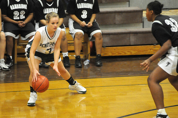 Haverhill: Emily Lane (3) of Pentucket looks to move the ball against Cambridge's Mykaliah Best (32) during Monday night's game at Haverhill High School. Photo by Ben Laing/Newburyport Daily News Monday December 29, 2008.