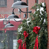 Newburyport: These Christmas wreaths hung along Inn Street get a touch of white to go with the red and green as this Friday's snow storm struck the area around 2pm. Photo by Ben Laing/Newburyport Daily News Friday December 19, 2008.