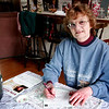 Amesbury: Jane Millette, an Amesbury resident, has been without power since Friday. Here she sits at her kitchen table with a battery powered latern as she fills out some Christmas cards. Photo by Ben Laing/Newburyport Daily News Monday December 15, 2008.