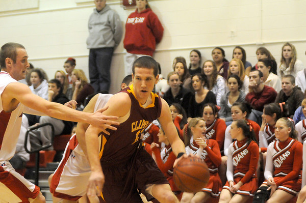 Amesbury: Newburyport's Joe Clancy (11) weaves his way past Indian defenders during Thursday night's basket ball game at Amesbury High. Photo by Ben Laing/Newburyport Daily News Thursday December 18, 2008.