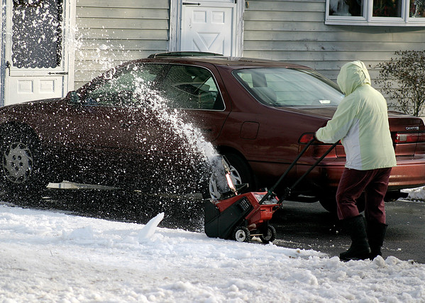 Newburyport: With snow predicted for Friday, area residents finishing cleaning up the mess from our last storm, like this woman on Turkey Hill Road. Photo by Ben Laing/Newburyport Daily News Thursday December 18, 2008.