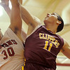 Amesbury: Newburyport's Joe Clancy (11) is met in mid-air by Amesbury's Steve Serwon (30) on his way to the basket during Thursday night's basketball game at Amesbury High. Photo by Ben Laing/Newburyport Daily News Thursday December 18, 2008.