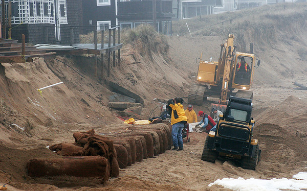 Newbury: Work continues on the sand bags along the beach at Plum Island center as workers try to protect the remaining homes along the dune. Photo by Ben Laing/Newburyport Daily News Monday, December 1, 2008.
