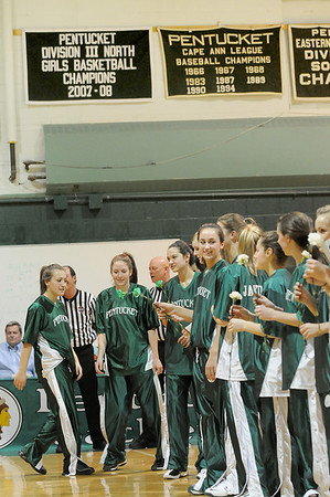 West Newbury: The Pentucket girls basketball team stands at center court, below the newly hung championship banner for last season's team which advanced to the Eastern Massachusetts finals in Boston. Photo by Ben Laing/Newburyport Daily News Monday December 22, 2008.