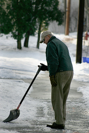 Newburyport: Newburyport resident Bill Abbott clears of the sidewalk in front of his Marlboro St. home Thursday afternoon in preperation for Friday's predicted snow storm. Photo by Ben Laing/Newburyport Daily News Thursday December 18, 2008.