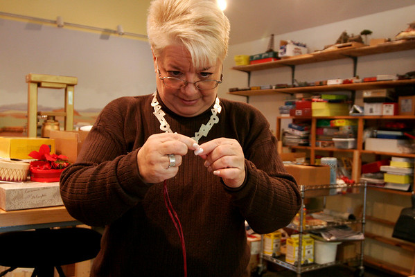 Newbury: Paula Wright threads a needle at she prepares to demonstrate some unique gift wrapping ideas at her home in Newbury. Photo by Ben Laing/Newburyport Daily News Monday December 15, 2008.