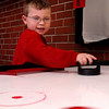 Salisbury:<br /> With really no snow for sledding, and ponds not cold enough for ice skating, the Boys and Girls Club in Salisbury is a popular spot for children during school vacation this week. Gavin McGrail, 6, was playing air hockey there with Kerriann Connell, 9, on Monday.<br /> Photo by Bryan Eaton/Newburyport Daily News Monday, December 29, 2008