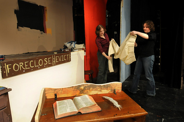 """Amesbury:<br /> """"A Christmas Carol"""" stage manager Kate Gilbert, left, works on the office set of Ebenezer Scrooge with sister Kim, who is directing the classic play at the Amesbury Playhouse.<br /> Photo by Bryan Eaton/Newburyport Daily News Wednesday, December 03, 2008"""