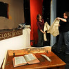 "Amesbury:<br /> ""A Christmas Carol"" stage manager Kate Gilbert, left, works on the office set of Ebenezer Scrooge with sister Kim, who is directing the classic play at the Amesbury Playhouse.<br /> Photo by Bryan Eaton/Newburyport Daily News Wednesday, December 03, 2008"