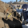 Newbury:<br /> John Rossi of Newburyport digs in to the mounds of sand as he and many volunteers fill sandbags for the erosion battle at Plum Island.<br /> Photo by Bryan Eaton/Newburyport Daily News Saturday, December 13, 2008
