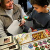 Salisbury:<br /> Holly Janvrin helps Dylan Bistany, 6, decide if he likes a certain glow ball he bought as a gift at the Holiday Santa Workshop at Salisbury Elementary School. Money raised from the children shopping there goes to the Salisbury PTA which Janvrin is a member of.<br /> Photo by Bryan Eaton/Newburyport Daily News Thursday, December 18, 2008