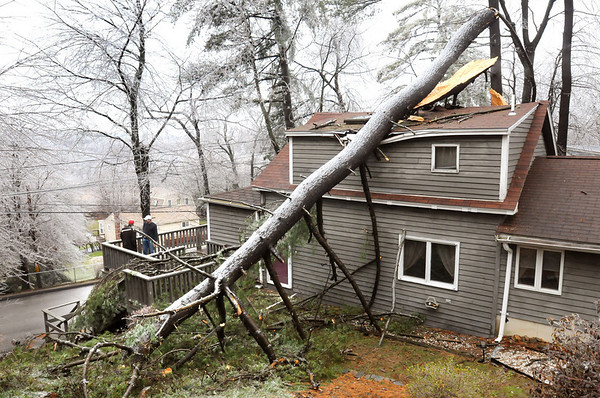 Merrimac:<br /> A giant white pine tree snapped landing on Brian Buckley's home on Pleasant View Avenue in Merrimac which is near the boat ramp on Attitash Street.<br /> Photo by Bryan Eaton/Newburyport Daily News Friday, December 12, 2008