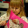 Newburyport:<br /> Violet Merrill, 6, cuts out hearts to create a piece of artwork for a friend in Mary Ahern's class at the Bresnahan School in Newburyport on Thursday morning. The children were having recess indoors due to the rain.<br /> Photo by Bryan Eaton/Newburyport Daily News Thursday, December 11, 2008