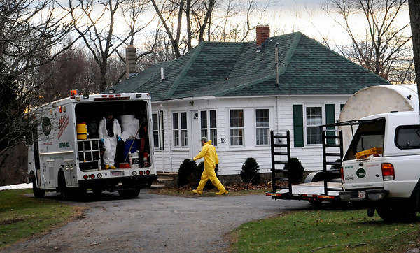 West Newbury:<br /> A crew from Enpro pumped oil from the basement at this home on 12 Bridge Street in West Newbury that was accidentally spilled.<br /> Photo by Bryan Eaton/Newburyport Daily News Tuesday, December 02, 2008
